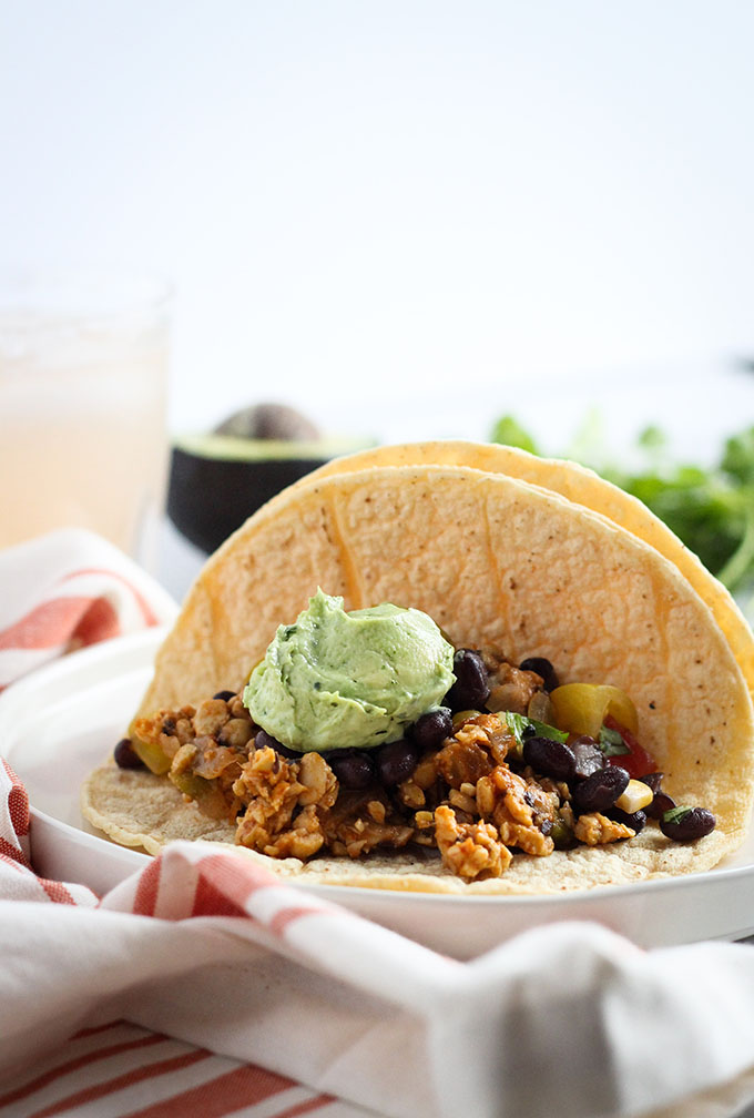 Chipotle tempeh tacos with black bean salsa and avocado crema