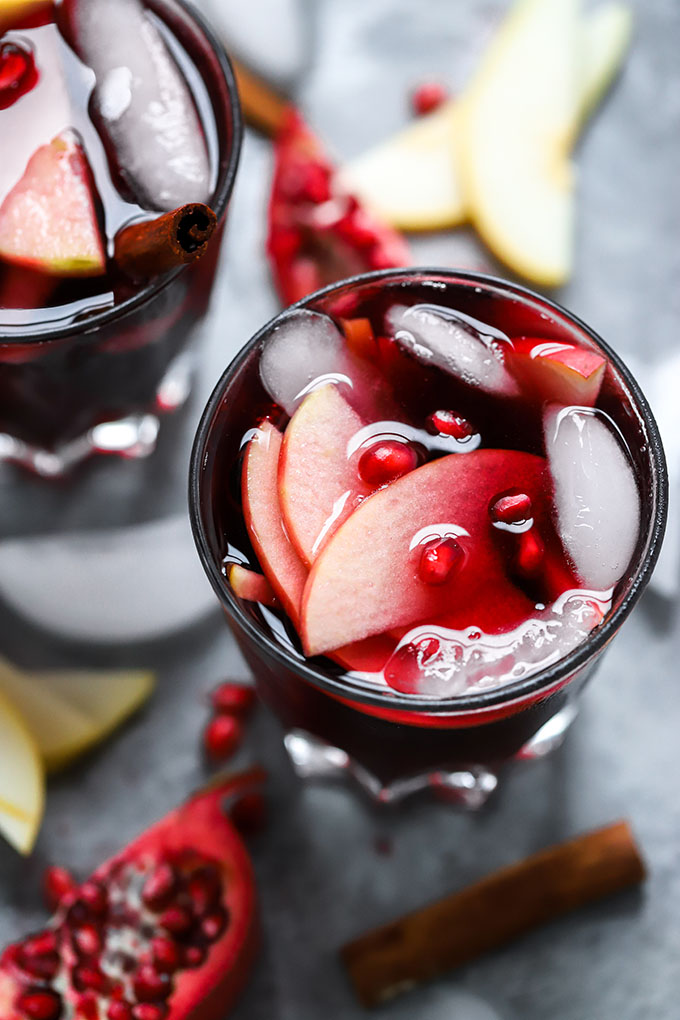 Pomegranate Ginger Sangria | The perfect simple cocktail for winter gatherings made with red wine, ginger kombucha and fruit!