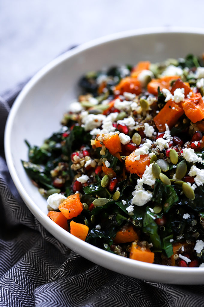 Winter Kale Salad | A healthy addition to your holiday gatherings! Made with roasted butternut squash, pomegranate, and goat cheese.
